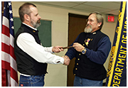 Department Commander Kim Heltemes presents incoming Camp Commander Young the gavel of authority December 2013.